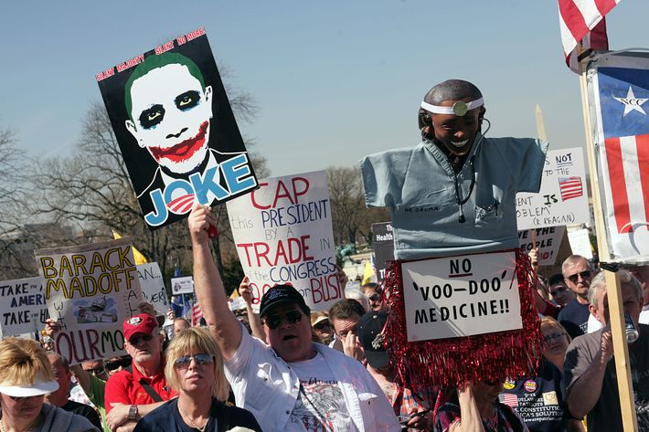 People rally in opposition to government reform of health care in Washington, DC, on March 20, 2010. The