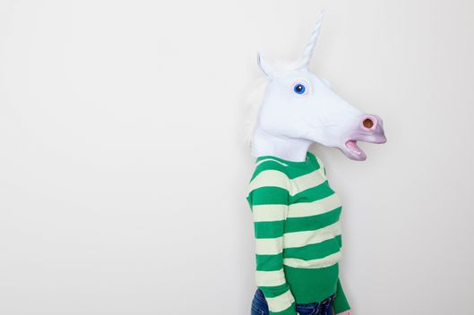 Girl wearing unicorn head