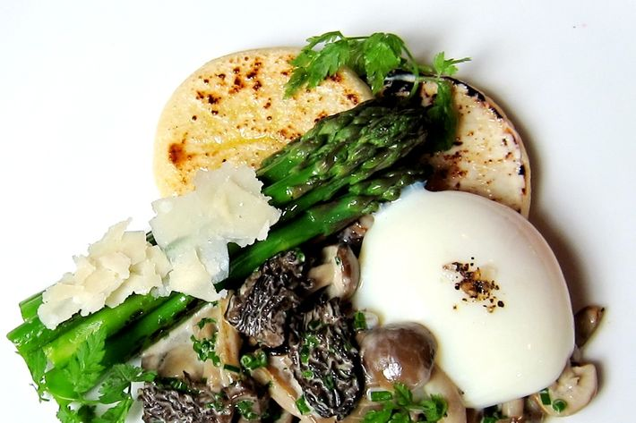 Farm egg with asparagus, morels, and a housemade English muffin.