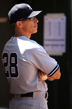 OAKLAND, CA - JULY 22:  Manager Joe Girardi #28 of the New York Yankees watches from the dugout during the game against the Oakland Athletics at O.co Coliseum on Sunday, July 22, 2012 in Oakland, California. (Photo by Brad Mangin/MLB Photos via Getty Images) *** Local Caption *** Joe Girardi