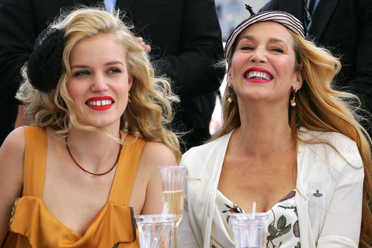 Model Georgia May Jagger (L) and her mother Jerry Hall judge a fashion parade during Crown Oaks Day at Flemington Racecourse on November 4, 2010 in Melbourne, Australia.