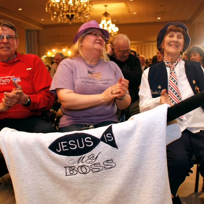 SHELBY TOWNSHIP, MI - FEBRUARY 17: (L-R) Troy and Cecilia Simonsen of Romeo, Michigan, along with Madeline Sheff of Shelby, Michigan, wait to see Republican presidential candidate and former U.S. Sen. Rick Santorum (R-PA) speak at a campaign rally February 17, 2012 in Shelby Township, Michigan. The rally was sponsored by the Michigan Faith and Freedom Coalition and various local Tea Party organizations. (photo by Bill Pugliano/Getty Images)