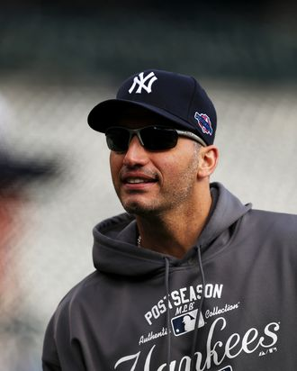 Andy Pettitte #46 of the New York Yankees looks on during batting practice against the Detroit Tigers during game four of the American League Championship Series at Comerica Park on October 18, 2012 in Detroit, Michigan.