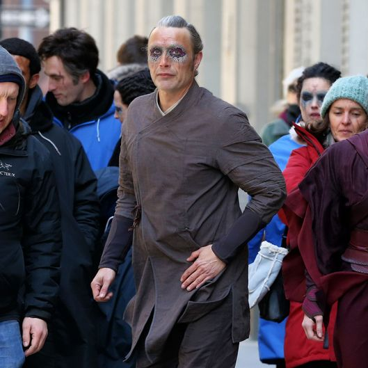 Danish actor Mads Mikkelsen and Zara Phythian film in character for 'Dr. Strange' in New York City
