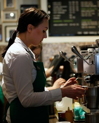 A barista prepares a drink at Starbucks