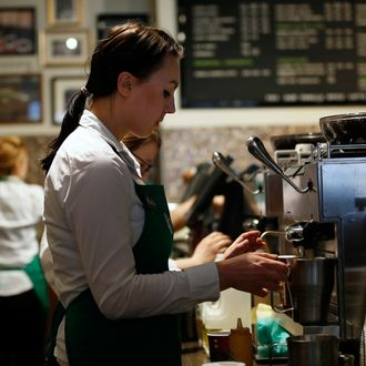 A barista prepares a drink at Starbucks