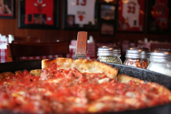 "<b>Deep Dish Sausage</b>    <a href=""http://chicago.menupages.com/restaurants/pizanos-pizza-pasta-2/"">Pizano's Pizza and Pasta</a>    <i>Chicago</i>  The same year (1943) that Enrico Fermi's atomic scientists made the first atomic pile, the first Chicago pizza was being pushed into an oven a few miles north at Pizzeria Uno. The crust of this original Chicago style is a buttery short dough, hard and biscuitlike, forming a shell strong enough to hold the thick layer of cheese, toppings (preferably including the fennel-heavy Italian sausage favored in Chicago), and crushed tomatoes. Historians dispute whether the real inventor was owner Ike Sewell or chef Rudy Malnati, but locally it's the Malnati family that carries the tradition on with the Lou Malnati's and Pizano's chains founded by different sons of Rudy Sr."