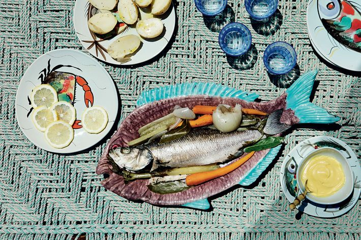 A fish served on a fish plate, at the Missonis dinner table — The Strategist reviews homeware.