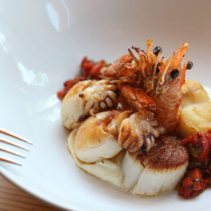 Plancha Marina with scallop, seppiolini, head-on shrimp, monkfish, roasted peppers, and aïoli.