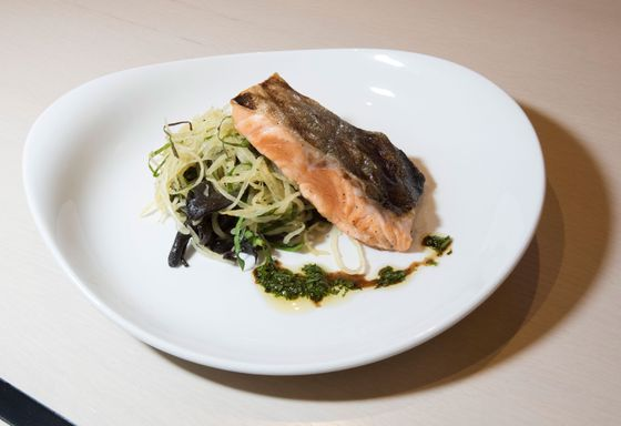 Wild Alaskan salmon with spaghetti squash, turnip greens, and black trumpet mushrooms.