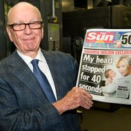 BROXBOURNE, UNITED KINGDOM - FEBRUARY 25:  (EDITORS NOTE: THIS IMAGE IS FREE FOR USE UNTIL MARCH 3 2012)  In this handout photograph provided by News International, Rupert Murdoch, Chairman and CEO of News Corporation, reviews the first edition of The Sun On Sunday as it comes off the presses on February 25, 2012 in Broxbourne, England. Around 3 million copies of 'The Sun On Sunday', the first ever Sunday edition of News Corporation's daily newspaper 'The Sun', are due to go on sale on Sunday February 26, 2012.  (Picture Arthur Edwards/News International via etty Images)