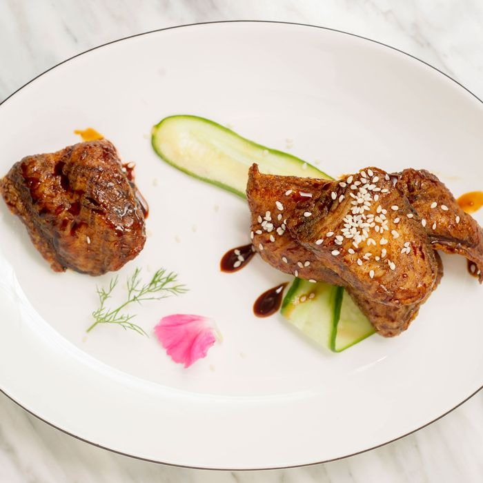 Traditional appetizers include sweetly smoked bone-in sole with sweet-and-sour soy sauce.
