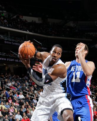 Dwight Howard #12 of the Orlando Magic controls the ball against Brook Lopez #11 of the New Jersey Nets on February 22, 2012 at the Prudential Center in Newark, New Jersey.