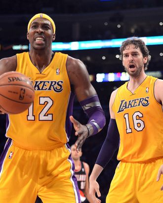 Pau Gasol #16 and Dwight Howard #12 of the Los Angeles Lakers react to a foul call during the game against the Portland Trail Blazers at Staples Center on December 28, 2012 in Los Angeles, California. The Lakers won 104-87.
