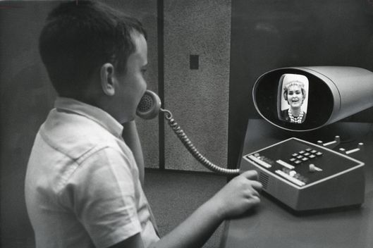 "QUEENS, NY-- Aug. 4, 1964 -- VIRTUAL TELEPHONE 1964 WORLD'S FAIR --  A visual telephone is demonstrated at the Bell Telephone Pavilion on August 4, 1964 at the 1964 World' Fair in New York.  The published caption stated that ""Communications generally wil be sight-sound by 2014.""  (Sam Falk/The New York Times)"
