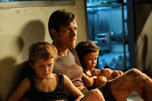 (L to R)  SAMUEL JOSLIN,  EWAN McGREGOR and OAKLEE PENDERGAST,  star in THE IMPOSSIBLE
