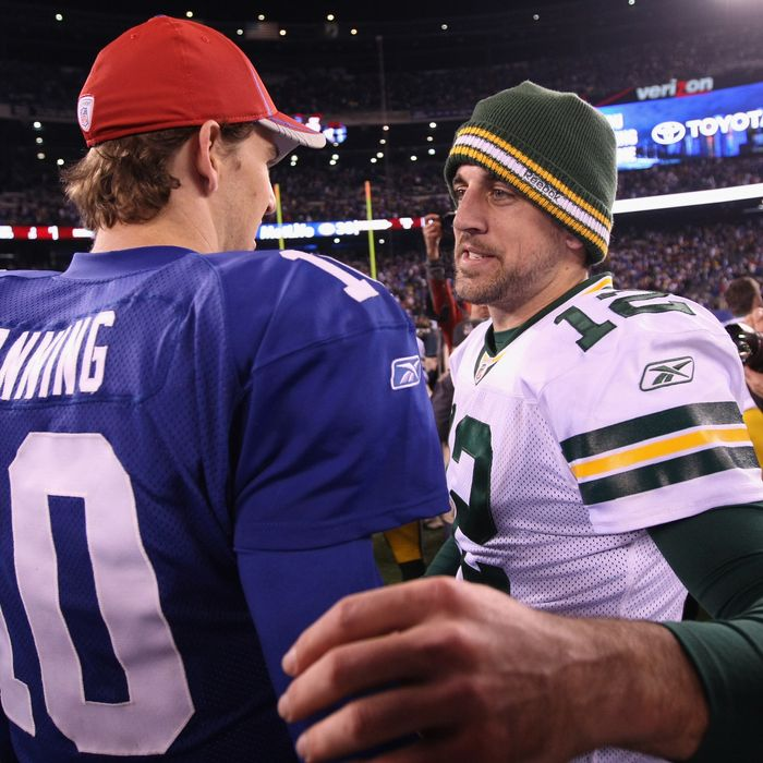 EAST RUTHERFORD, NJ - DECEMBER 04: (L-R) Eli Manning #10 of the New York Giants congratulates Aaron Rodgers #12 of the Green Bay Packers after the Packers won 38-35 at MetLife Stadium on December 4, 2011 in East Rutherford, New Jersey.