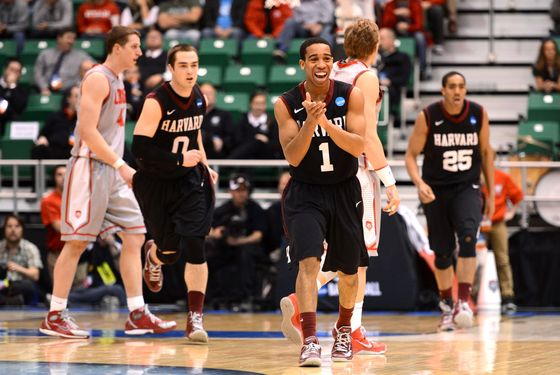 SSiyani Chambers #1 of the Harvard Crimson celebrates after making a three-pointer in the second half while taking on the New Mexico Lobos during the second round of the 2013 NCAA Men's Basketball Tournament at EnergySolutions Arena on March 21, 2013 in Salt Lake City, Utah.