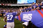 EAST RUTHERFORD, NJ - SEPTEMBER 19: Brandon Jacobs #27 of the New York Giants celebrates with fans after the Giants won 28-16 against the St. Louis Rams at MetLife Stadium on September 19, 2011 in East Rutherford, New Jersey. (Photo by Al Bello/Getty Images)