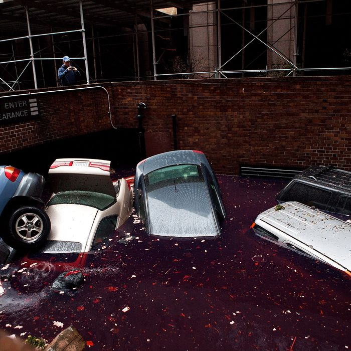 NEW YORK, NY - OCTOBER 30: Cars floating in a flooded subterranian basement following Hurricaine Sandy on October 30, 2012 in the Financial District of New York, United States. The storm has claimed at least 16 lives in the United States, and has caused massive flooding accross much of the Atlantic seaboard. US President Barack Obama has declared the situation a 'major disaster' for large areas of the US East Coast including New York City. (Photo by Andrew Burton/Getty Images)