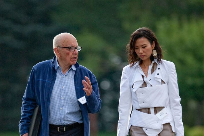 Rupert Murdoch, chairman and chief executive officer of News Corp., left, and his wife Wendi Deng arrive for the morning session at the Allen & Co. Media and Technology Conference in Sun Valley, Idaho, U.S., on Saturday, July 14, 2012. Media moguls gathered at the annual Allen & Co. conference have spent recent years contemplating how to cope with technology companies drawing audiences away from television and movies.