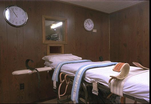 A padded gurney in the execution chamber of the Montana State Prison in DeerLodge, Montana is shown off Wednesday Feb. 11, 1998. Convicted murderer Terry Langford is slated to die by injection Feb. 24, 1998.  (AP Photo/Montana Standard, Walter Hinick)