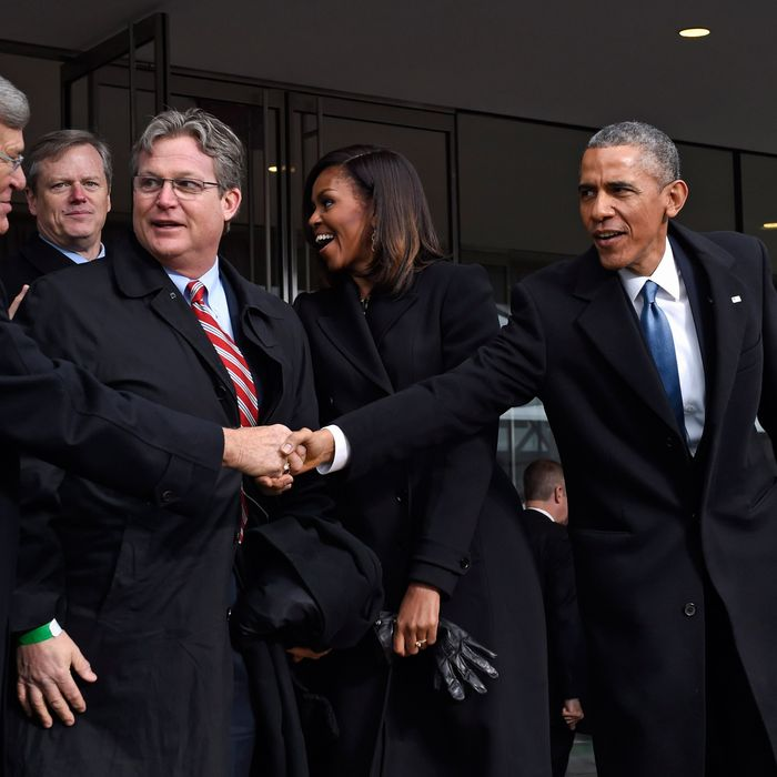 30 Mar 2015, Boston, Massachusetts, USA --- President Barack Obama shakes hands with former Senate Majority Leader Trent Lott of Mississippi, as Connecticut State Sen. Ted Kennedy Jr., watches during the dedication of the Edward M. Kennedy Institute for the United States Senate in Boston, Monday, March 30, 2015. The $79 million Edward M. Kennedy Institute for the United States Senate dedication is a politically star-studded event attended by President Barack Obama, Vice President Joe Biden and past and present senators of both parties. It sits next to the presidential library of Kennedy's brother, John F. Kennedy. From left are, Lott, Massachusetts Gov. Charlie Baker, first lady Michelle Obama, the president, Sen. Elizabeth Warren, D-Mass., and Sen. Edward Markey, D-Mass. (AP Photo/Susan Walsh) --- Image by ? Susan Walsh/AP/Corbis