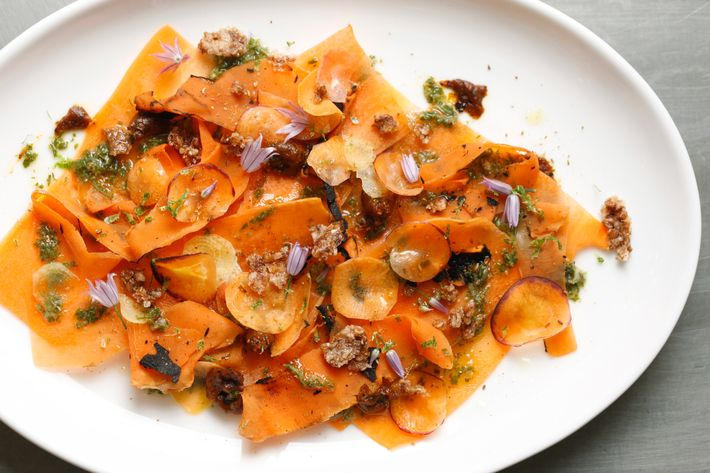 Carrot carpaccio with buckwheat and carrot top gremolata.