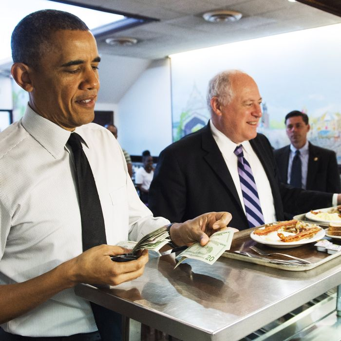 US President Barack Obama and Illinois Governor Pat Quinn (R) order breakfast during a surprise visit to Valois Cafeteria in Chicago, Illinois on May 23, 2014. Obama returns to Washington later today.