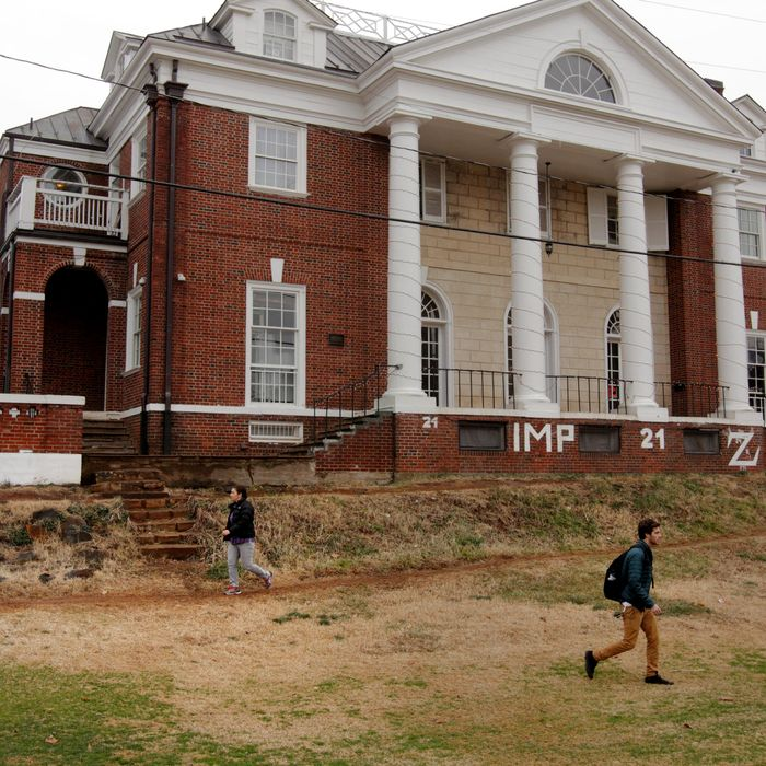 Students walk past the Phi Kappa Psi fraternity house on the University of Virginia campus on December 6, 2014 in Charlottesville, Virginia. On Friday, Rolling Stone magazine issued an apology for discrepencies that were published in an article regarding the alleged gang rape of a University of Virginia student by members of the Phi Kappa Psi fraternity.