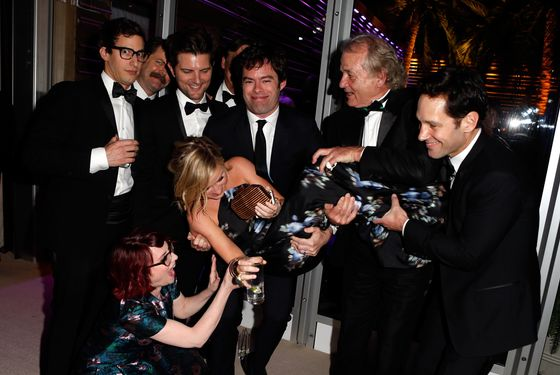 WEST HOLLYWOOD, CA - MARCH 02:  (EXCLUSIVE ACCESS, SPECIAL RATES APPLY) (L-R) Actors Andy Samberg, Nick Offerman, Megan Mullally (in front, crouching), Adam Scott, Amy Poehler (being held), Bill Hader, Bill Murray, and Paul Rudd attend the 2014 Vanity Fair Oscar Party Hosted By Graydon Carter on March 2, 2014 in West Hollywood, California.  (Photo by Jeff Vespa/VF14/WireImage)