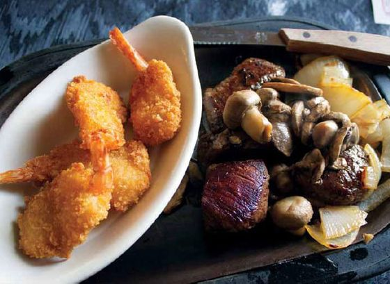 A specialty of the house at Buck-A-Neer Supper Club in Stratford is their version of surf and turf— fried shrimp and tenderloin kabobs.