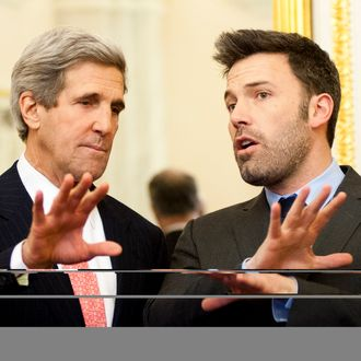 John Kerry and Ben Affleck pose for a photo during a meeting with members of the Senate Foreign Relations Committee in the U.S. Capitol on December 19, 2012 in Washington, DC.