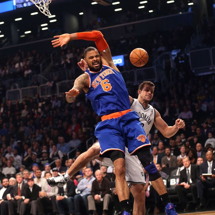 Kris Humphries #43 of the Brooklyn Nets fouls Tyson Chandler #6 of the New York Knicks at the Barclays Center on November 26, 2012 in the Brooklyn borough of New York City.