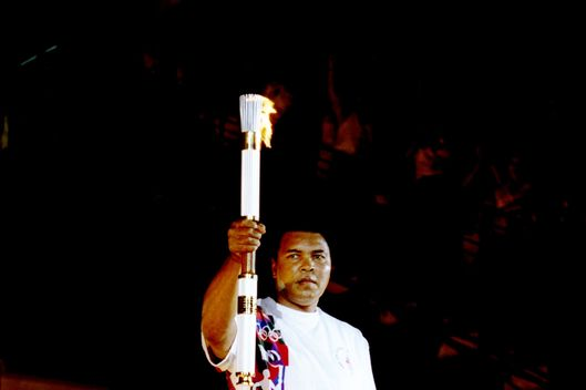 Muhammad Ali holds the torch before lighting the Olympic Flame during the Opening Ceremony of the 1996 Centennial Olympic Games in Atlanta, Georgia.