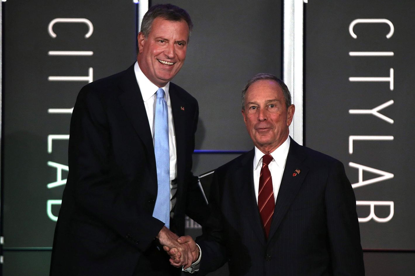 "Democratic nominee for New York Mayor Bill de Blasio (L) appears on stage with current New York Mayor Michael Bloomberg at ""CityLab: Urban Solutions to Global Challenges,"" an event sponsored by The Atlantic, The Aspen Institute, and Bloomberg Philanthropies on October 8, 2013 in New York City. The event, which took place on October 6-8, brought together 300 global city leaders, city planners, scholars, architects, artists and others for a symposium on urban ideas."