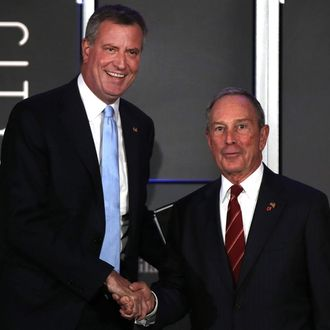 Democratic nominee for New York Mayor Bill de Blasio (L) appears on stage with current New York Mayor Michael Bloomberg at