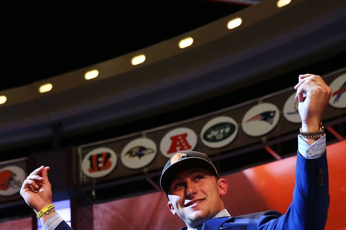NEW YORK, NY - MAY 08:  Johnny Manziel of the Texas A&M Aggies takes the stage after he was picked #22 overall by the Cleveland Browns during the first round of the 2014 NFL Draft at Radio City Music Hall on May 8, 2014 in New York City.  (Photo by Elsa/Getty Images)