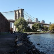 NEW YORK - OCTOBER 19:  The Brooklyn Bridge is viewed from the shore at a park October 19, 2009 in the Brooklyn borough of New York City. A new report by the Organization for Economic Cooperation and Development (OECP) finds that rising sea levels due to global warming threatens some of the world's major cities. According to the report, seas are rising twice as fast as recently projected threatening such sea level cities as New York, Miami, London, Tokyo, Mumbai and Amsterdam. World leaders are scheduled to meet in Copenhagen, Denmark in December for the UN-sponsored climate-change conference where issues such as rising sea levels are to be discussed.  (Photo by Spencer Platt/Getty Images)