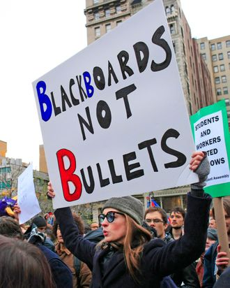 Anne Hathaway carries signs reading 'Blackboards not Bullets' and 'Blackboards not Banks' as she protests at Union Square on for the Occupy Wall Street campaign with her boyfriend Adam Shulman. She then proceeded to march down the street along with the other protestors. <P> Pictured: Anne Hathaway <P> <B>Ref: SPL335630 171111 </B><BR/> Picture by: Splash News<BR/> </P><P> <B>Splash News and Pictures</B><BR/> Los Angeles:310-821-2666<BR/> New York:212-619-2666<BR/> London:870-934-2666<BR/> photodesk@splashnews.com<BR/> </P>