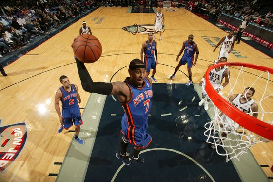 NEWARK, NJ - DECEMBER 17: Carmelo Anthony #7 of the New York Knicks dunks against the New Jersey Nets during the preseason game on December 17, 2011 at the Prudential Center in Newark, New Jersey.  NOTE TO USER: User expressly acknowledges and agrees that, by downloading and or using this photograph, User is consenting to the terms and conditions of the Getty Images License Agreement. Mandatory Copyright Notice: Copyright 2011 NBAE  (Photo by Nathaniel S. Butler/NBAE via Getty Images)