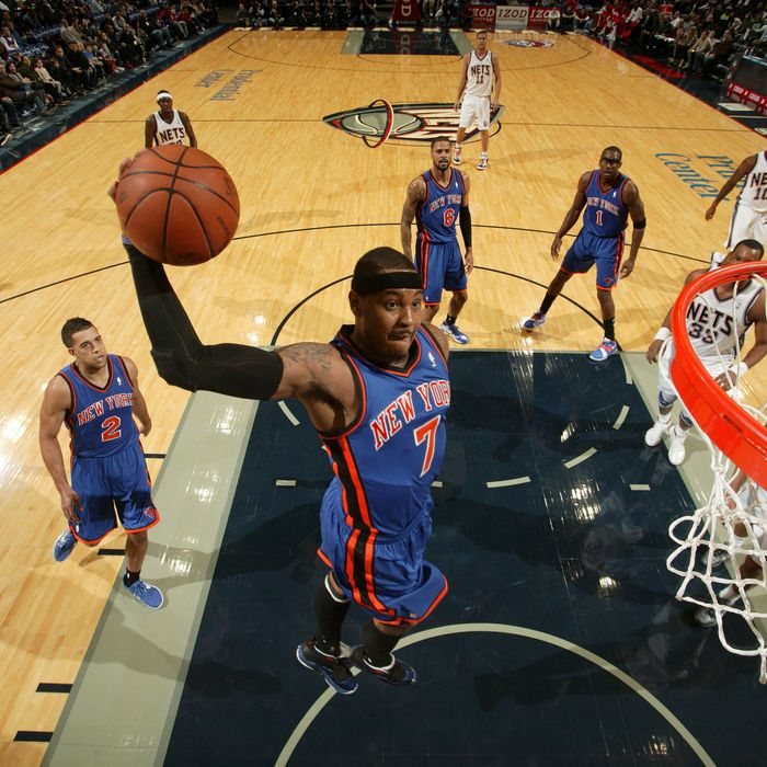 Carmelo Anthony #7 of the New York Knicks dunks against the New Jersey Nets during the preseason game on December 17, 2011.