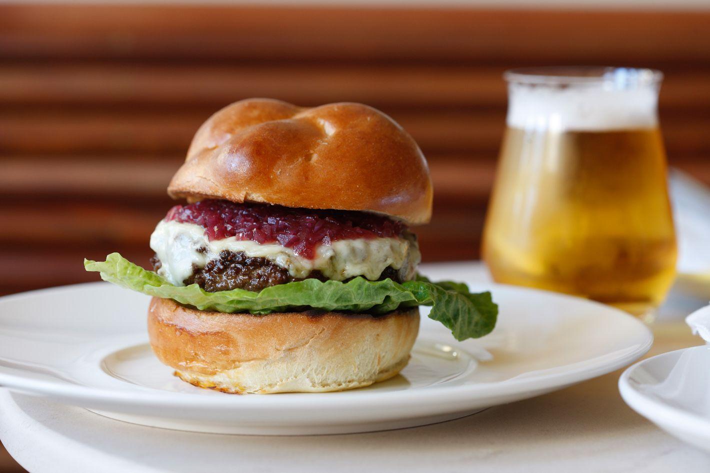 Freud Burger with farmhouse cheddar, onion jam, and crispy fennel.