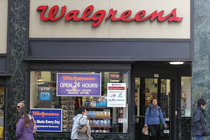SAN FRANCISCO, CA - JUNE 19:  People walk by a Walgreens store on June 19, 2012 in San Francisco, California.  U.S. based drug store chain Walgreens has announced a deal to purchase a 45 percent stake in European pharmacy retailer Alliance Boots for $6.7 billion. The acquisition will make Walgreens one of the world's largest drug store and pharmacy retailers with 11,000 stores in 12 countries.  (Photo by Justin Sullivan/Getty Images)
