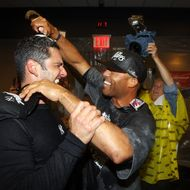 NEW YORK, NY - SEPTEMBER 21: Jorge Posada #20 and Mariano Rivera #42 of the New York Yankees celebrate after clinching the American League East division against the Tampa Bay Rays on September 21, 2011 at Yankee Stadium in the Bronx borough of New York City. (Photo by Jim McIsaac/Getty Images)