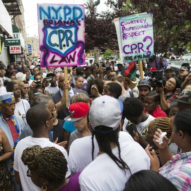 19 Jul 2014, New York City, New York State, USA --- Demonstrators gather at the site of Eric Garner's death on a march following a service held in his name at the Mount Sinai Center for Community Enrichment, Saturday, July 19, 2014, in New York. in the Staten Island borough of New York.
