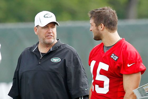CORTLAND, NY - JULY 27:  Tim Tebow #15 of the New York Jets talks with head coach Rex Ryan of the New York Jets at Jets Training Camp at SUNY Cortland on July 27, 2012 in Cortland, New York.  (Photo by Jeff Zelevansky/Getty Images)