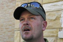 "Samuel Joseph Wurzelbacher, or ""Joe the Plumber"", looks at a building hit by a rocket launched by Gaza Strip militants in the coastal Israeli city of Ashkelon on January 12, 2009.  Joe the Plumber"", is morphing into ""Joe the War Correspondent"". He traveled to Israel to report for US conservative website pjtv.com, giving the perspective of ordinary Israelis on the conflict in Gaza."