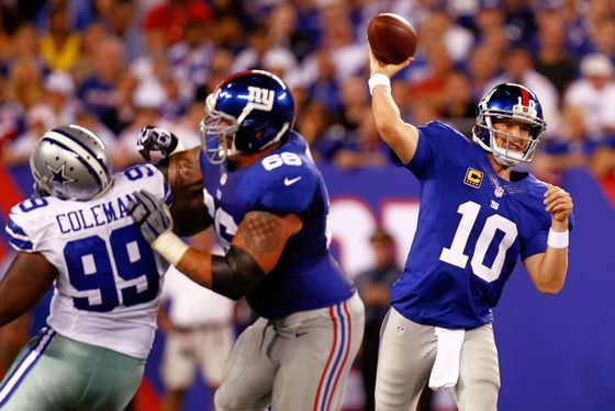 EAST RUTHERFORD, NJ - SEPTEMBER 05:  Quarterback Eli Manning #10 of the New York Giants drops back to pass against the Dallas Cowboys during the 2012 NFL season opener at MetLife Stadium on September 5, 2012 in East Rutherford, New Jersey.  (Photo by Jeff Zelevansky/Getty Images)