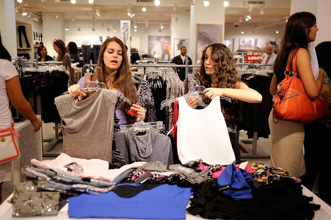 Christina Sikic and Jennifer Sikic of Staten Island, NY sort through pieces from the ?Material Girl? clothing line by Madonna at the Material Girl clothing line launch at Macy's Herald Square on August 3, 2010 in New York City.